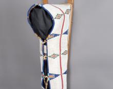 Cheyenne fully beaded cradle with tacked boards with trade cloth lining on Native tanned buffalo hide Plains indian art for sale purchase consign auction